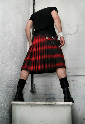 Kilted man on sink postcard
